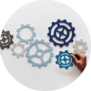 Cogs being placed on white background depicting modular nature of SHE Softwares health and safety solution
